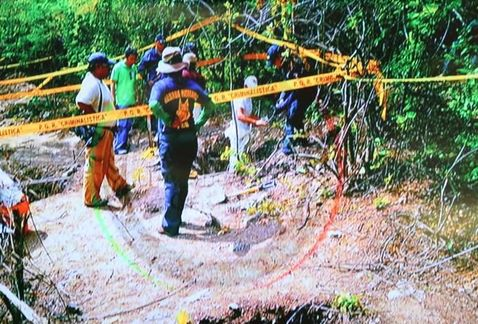 Authorities look into the mass graves found days after the attacks.