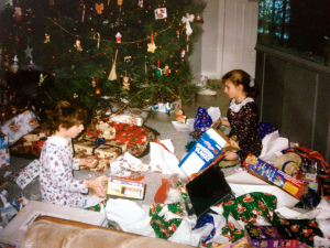 Christmas morning circa 1995. That's me looking prim and proper with a scrunch in my hair and lace on my nightgown.